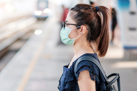 Young Asian woman wearing Surgical face mask