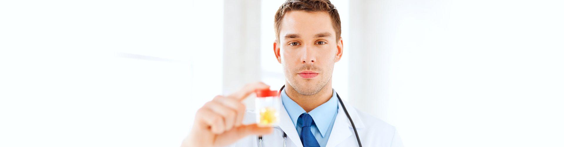 man holding medicine container